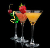 Three cocktails red cosmopolitan cocktails Stock Images