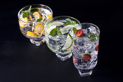 Three cocktails. Three refreshing cocktails on a black background Stock Photography