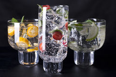 Three cocktails. Three refreshing cocktails on a black background Royalty Free Stock Image