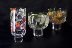 Three cocktails. Three refreshing cocktails on a black background Stock Image