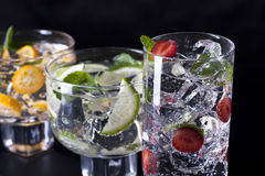 Three cocktails. Three refreshing cocktails on a black background Stock Images