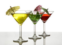 Three cocktails with umbrella Stock Photography