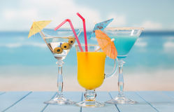 Three cocktails with umbrellas Royalty Free Stock Image
