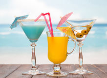 Three cocktails with umbrellas Royalty Free Stock Photos