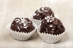 Three Coconut milk rice truffles Stock Photo