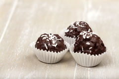 Three Coconut milk rice truffles Stock Image