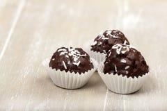 Three Coconut milk rice truffles Stock Image
