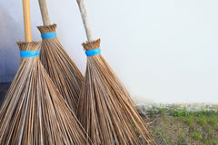 Three of coconuts leaf broom. This scene as a three of coconuts leaf broom Stock Photography