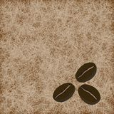 Three coffee beans on light brown background Royalty Free Stock Photos
