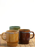 Three coffee cups. On a placemat Royalty Free Stock Photos