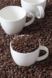 Three Coffee Cups and Beans Royalty Free Stock Photo