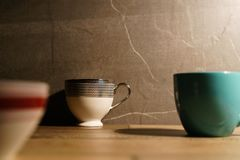 Three coffee cups lay down on the table stock photos