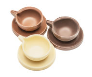 Three coffee cups and saucers made of chocolate Royalty Free Stock Image