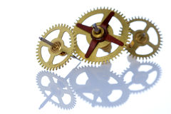 Three cog wheels and their reflection Stock Photos