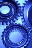 Three cogs. Closeup joining together Royalty Free Stock Image
