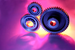 Three cogs. Three steel cogs connected together Stock Images