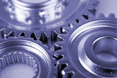Three cogs Stock Photos