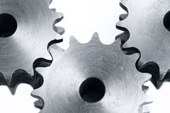 Three cogs on white background Stock Photos