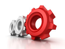 Three cogwheel gears with red leader on white background Royalty Free Stock Photos