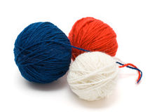 Three coil of yarn in red, blue and white. Isolated on a white background Stock Photo