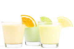 Three cold citrus fruit milkshakes Royalty Free Stock Images