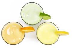 Three cold citrus fruit milkshakes from top Stock Image