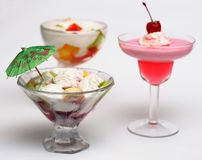 Three cold desserts. Three tasty cold desserts with ice-cream and fruit royalty free stock images