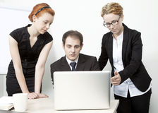 Three colleagues brainstorming Royalty Free Stock Image