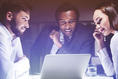 Three colleagues are discussing their business prospects Royalty Free Stock Images