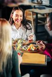 Three colleagues having dinner together after hard working day. Three colleagues. Three colleagues having delicious dinner together after hard working day royalty free stock image