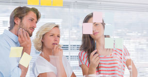 Three colleagues looking thoughtful Stock Photo