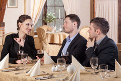 Three colleagues sitting in restaurant Royalty Free Stock Image