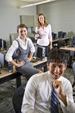 Three college students in computer lab Royalty Free Stock Photo