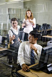 Three college students in library computer room Stock Images