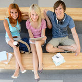 Three college students looking camera top view Stock Photography