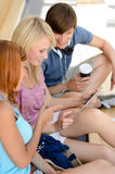 Three college students looking at tablet sitting royalty free stock photos