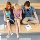 Three college students looking tablet top view Royalty Free Stock Photography