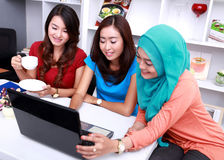 Three college students in a study group. Portrait of three beautiful college students look happy in a study group Stock Photo