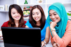 Three college students in a study group. Portrait of three beautiful college students look happy in a study group Stock Photos