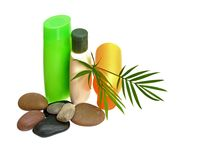 Three coloful shampoo bottles and stone Stock Images