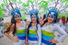 Three colombian girls dancers with colorful and Royalty Free Stock Image