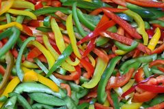 Three color bell peppers stock photography