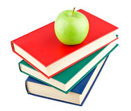 Three color books and green apple. On white background royalty free stock photo