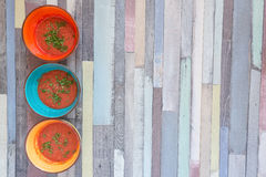 Three color bowls with tomato gazpacho soup Royalty Free Stock Photo