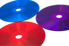 Three color CD compact discs: red, blue and violet. Isolated on white Stock Photo