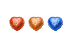 Three color chocolate hearts candy on white background Royalty Free Stock Photography