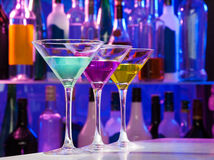 Three color cocktail glasses on the bar table Royalty Free Stock Images