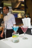 Three color cocktails preparing on the bar counter Royalty Free Stock Images