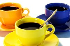 Three color coffee cups. Stock Image