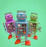 Three color confused retro robots Stock Image